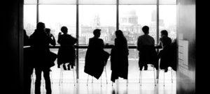 People in a board room talking